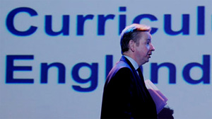 Michael Gove leaving a platform on the National Curriculum